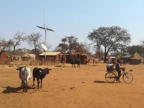African Village with telecoms tower
